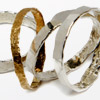 Four stacking rings with hammered texture, three sterling silver & one 9ct gold